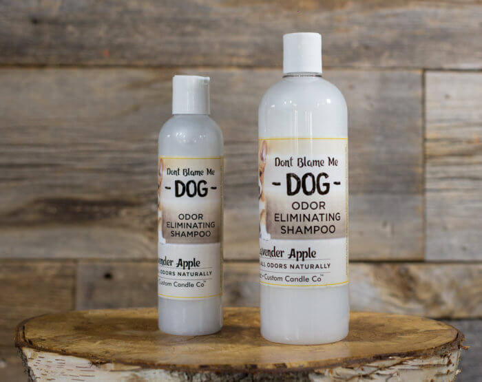 Large and Small Lavender and Apple Shampoo on wooden background