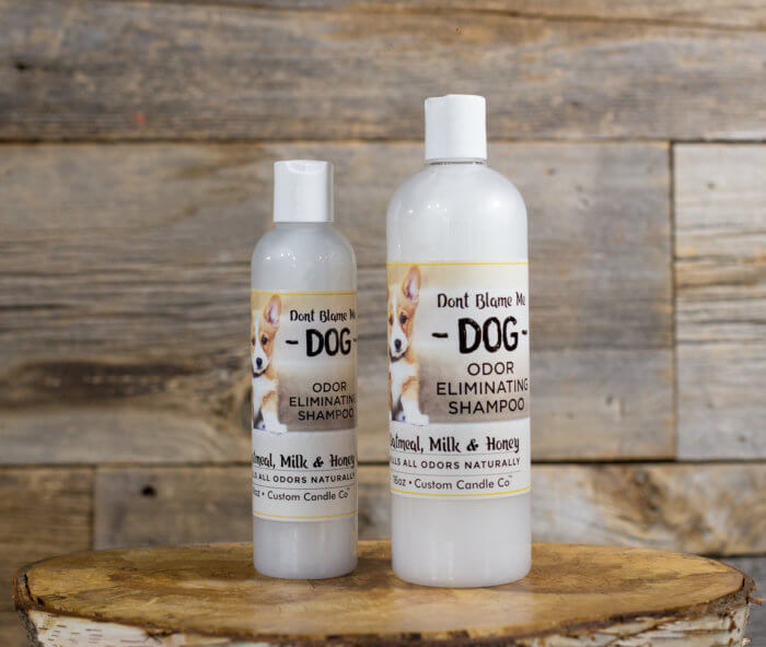 Large and Small Oatmeal Milk and Honey Dog Shampoo on Wooden Background